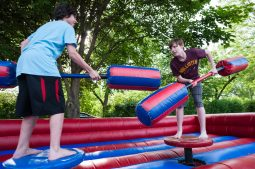 Aaron Bauer of Lombard and Jonah Raith of Riverside play inflatable jousting. | MAX HERMAN/Contributor