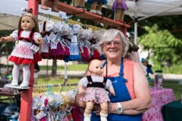 Isabelle Herdeg of Glen Ellyn poses with dolls dressed in hand-knitted dresses she has created for nearly 15 years. | MAX HERMAN/Contributor