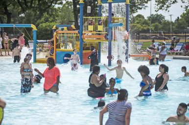 Family time in the shallow end last Saturday during the 20th anniversary of the Forest Park Aquatic Center. | WILLIAM CAMARGO/Staff Photographer