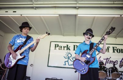 Nathan Bolet and Ryan Carlson of Nova compete in the battle of the bands in Forest Park last Saturday. | William Camargo/Staff Photographer