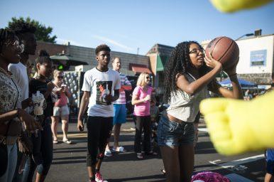 Keene Jones, left, tries her luck at basketball.   William Camargo/Staff Photographer