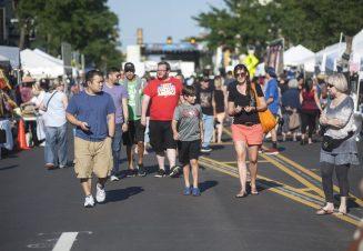 Crowd ambles down Madison Street.   William Camargo/Staff Photographer