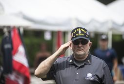 Ward, an Air Force veteran, salutes during the Pledge of Allegiance. | William Camargo/Staff Photographer