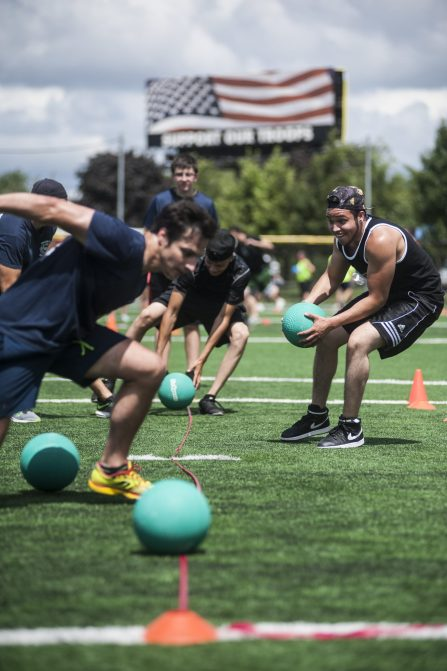 A race to the ball starts a dodgeball game during the charity event at The Park last Saturday. | William Camargo/Staff Photographer