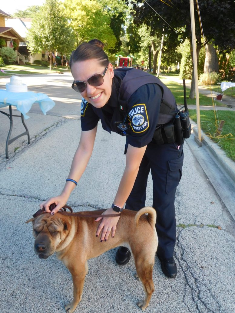 Officer Lauren Ballistoni and guard dog Ling-Ling. | JACKIE SCHULZ/Contributor