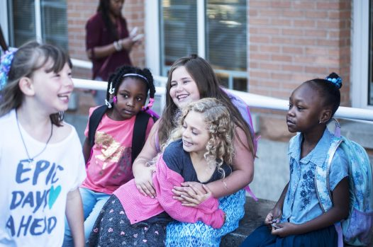 Friends catch up during the first day of school. | William Camargo/Staff Photographer