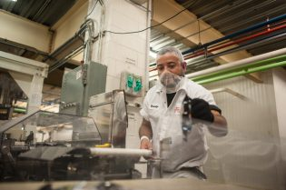 Rodolfo Fausto makes one of the last inspections of the Trolli gummy candies. | William Camargo/Staff Photographer