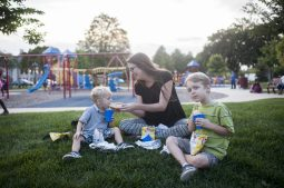 Jimmy and Frankie Hepner enjoy the concert in The Park with their mother Rosie.   William Camargo/Staff Photographer