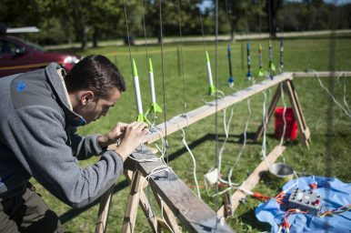 Reno George, a longtime scout, puts a rocket in position to launch during the Blasting into Scouts event in Miller Meadows-North on Saturday, Oct. 8.   William Camargo/Staff Photographer