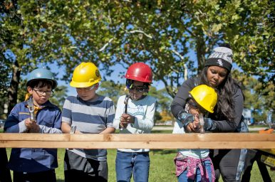 Young scouts from several surrounding communities, including Forest Park, hammer away.   William Camargo/Staff Photographer