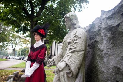 Lee Conte, a longtime volunteer at the Tales of the Tombstone walk in Forest Home Cemetery, talks about the history of her character on Oct.16. | William Camargo/Staff Photographer