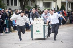 The Forest Park National Bank race down Beloit in their work clothes. | William Camargo/Staff Photographer