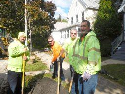 Paul Richards, Patrick Scollard, Patrick Braniff and Mike Marasco planting a linden tree. | JACKIE SCHULZ/Contributor