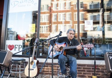 Tom Rocha added some music to the ambiance in front of Danche Guitars. | William Camargo/Staff Photographer