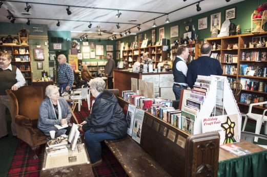 Customers shop and talk to authors at Centuries and Sleuths Bookstore during Small Business Saturday in Forest Park.   William Camargo/Staff Photographer