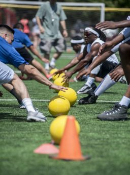 A race to the ball during a dodgeball game fundraiser in The Park on Saturday, Aug. 13.   File photo