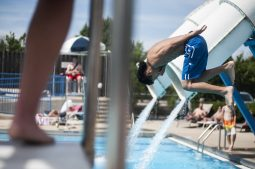 A teenager dives from the diving board at the aquatic center on June 18, as it celebrated its 20th anniversary.   File photo