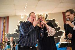 Forest Park Mayor Anthony Calderone joins Community Center Director Karen Dylewski in song. | MAX HERMAN/Contributor
