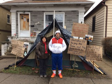 Xavier Murillo Guerrero and his wife, Juana Romero, outside their home in the 1100 block of Circle Avenue. A corporation has acquired the house after buying unpaid property taxes.