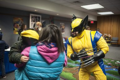 Wolverine meets a smaller wolverine during Flip-Con at the Forest Park Public Library on Jan. 14. | William Camargo/Staff Photographer