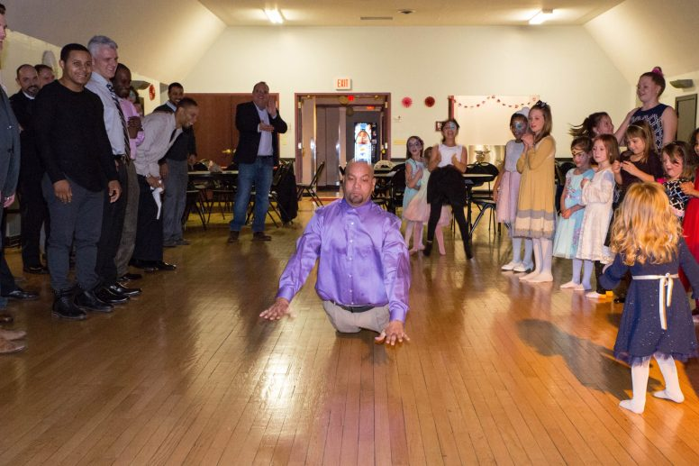 Junior Sanchez impresses daughter Marisol with the Worm during the Daddy-Daughter Dance at the Park District of Forest Park last Saturday.   Jason Schumer/Contributor