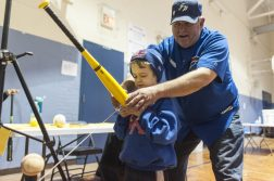Jimmy Hepner tries one of the baseball bat science activities. | William Camargo/Staff Photographer