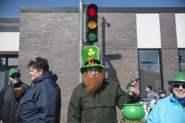 This leprechaun shows off his pot o' gold (or candy) during Saturday's St. Patrick's Parade on Madison Street where the sun shined along with the smiling eyes.   William Camargo/Staff Photographer