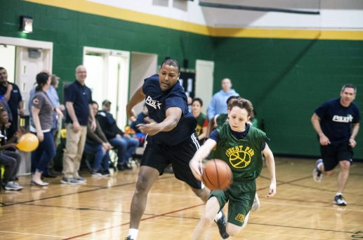 Forest Park Middle School player heads upcourt during a friendly game with the Forest Park police on St. Patrick's Day. | William Camargo/Staff Photographer