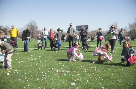 Children rush to fill their baskets during the Easter Egg Hunt at The Park last Saturday morning. | William Camargo/Staff Photographer