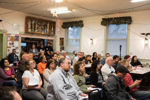 The audience listens to a panel discussion during the Live Town Hall: Welcoming Diversity at Eagles Hall on Monday night. | Max Herman/ Contributor