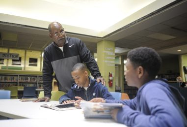 Bob Liddell helps Jabreal James and Brannon Young during a study session at the Forest Park Middle School. He will be retiring after this school year. | William Camargo/Staff Photographer