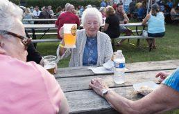 A festival-goer raises a liter of beer in toast at the German Fest celebration on June 9 at The Grove.   Sebastian Hidalgo/Contributor