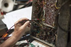Ed Huther working on a radio in his garage.   William Camargo/Staff Photographer