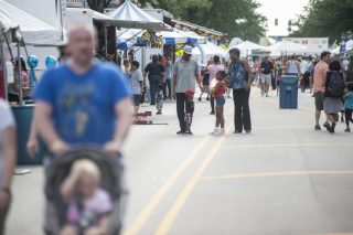 People enjoy a nice day at the Forest Park Music Fest on Saturday July 22, on Madison Street. | William Camargo/Staff Photographer