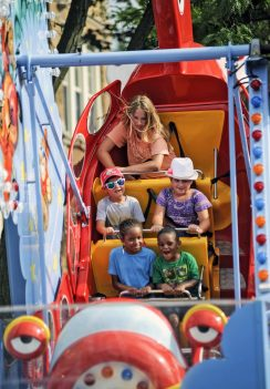 Children enjoy a ride at Forest Park Music Fest on July 22. The festival ran all weekend in downtown Forest Park. | William Camargo/Staff Photographer