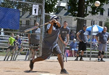 Adrian Alejandro hits the ball on July 29, at the 49th annual No Glove Nationals Softball Tournament at the Park District of Forest Park. | Alexa Rogals/Staff Photographer