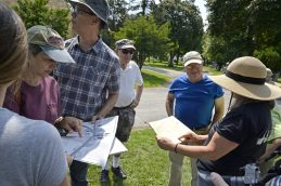 Attendees look over maps of the cemetery.   Alexa Rogals/Staff Photographer