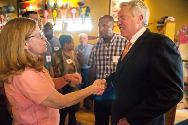 Mary Win Connor, D91 School Board president, introduces herself to democratic governor candidate Chris Kennedy on Friday, Aug. 11, during a private event at Old School Tavern and Grill in Forest Park. | Alexa Rogals/Staff Photographer