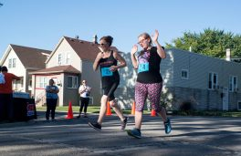Brooke Sievers, left, and Michelle Woehrle, both of Forest Park, prepare for their last lap of the race on Saturday, Aug. 12, during the 2nd annual Back to School 5K near Forest Park Middle School in Forest Park.   Alexa Rogals/Staff Photographer