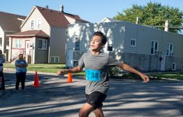 Camilo Medina, 14, of Forest Park, finishes the race in first place.   Alexa Rogals/Staff Photographer