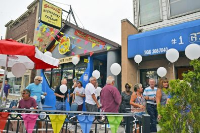 Attendees gather outside on Saturday, Aug. 26, during the 40th anniversary celebration at Starship on Madison Street in Forest Park. | Alexa Rogals/Staff Photographer