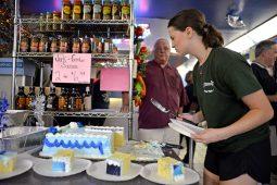 Starship manager Veronica Minor serves cake during the 40th anniversary celebration at Starship.   Alexa Rogals/Staff Photographer