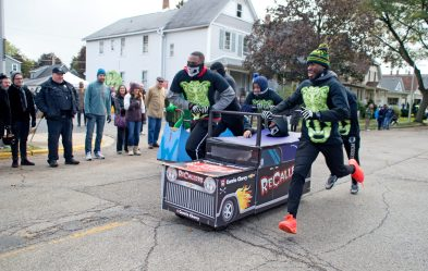 The Currie Motors team races on Saturday, Oct. 28, 2017, during the 6th annual Forest Park Chamber of Commerce Casket Races on Beloit Avenue, south of Madison Street in Forest Park, Ill. The Currie Motors team came in first place for the race. (ALEXA ROGALS/Staff Photographer)