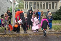 Children dressed up in their Halloween costumes watch the races on Saturday, Oct. 28, 2017, during the 6th annual Forest Park Chamber of Commerce Casket Races on Beloit Avenue, south of Madison Street in Forest Park, Ill. (ALEXA ROGALS/Staff Photographer)