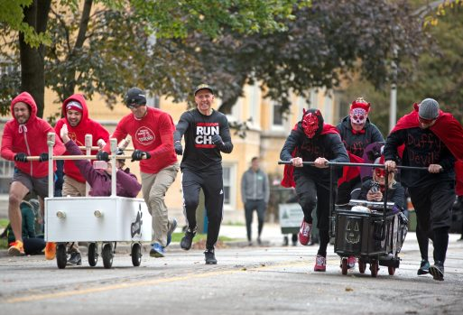 Teams race each other on Saturday, Oct. 28, 2017, during the 6th annual Forest Park Chamber of Commerce Casket Races on Beloit Avenue, south of Madison Street in Forest Park, Ill. (ALEXA ROGALS/Staff Photographer)