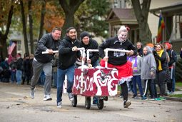 Teams run their caskets down the road for a parade before the race begins on Saturday, Oct. 28, 2017, during the 6th annual Forest Park Chamber of Commerce Casket Races on Beloit Avenue, south of Madison Street in Forest Park, Ill. (ALEXA ROGALS/Staff Photographer)