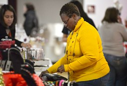 Sherri Ewing, of Chicago, sets up her Fresh As One Design table at the start of the sale. | Alexa Rogals/Staff Photographer