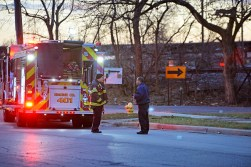 Forest Park firefighters talk outside of the accident on Wednesday, Dec. 20, 2017, on the 500 block of Jackson Boulevard in Forest Park, Ill. (Alexa Rogals | Staff Photographer)