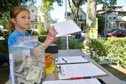 Storey Novak, 10, of Forest Park, receives donations from people throughout the community on Saturday, Sept. 2, at the Novaks' home on Hannah Avenue in Forest Park. | File photo