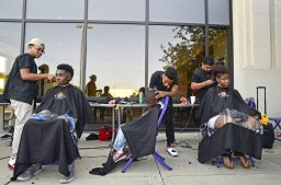Students with Erskine Reeves Barber Academy give free hair cuts to students on Friday, Aug. 18, during the Proviso Back To School Bash at the D209 District Office. | File photo